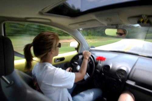 SAFTEY2.NE.062406.TEL: Sixteen-year-old Cassidy Cloninger  puts her 1999 Volkswagon Beetle to the test while being aided by instructor Tom Bohlmann, not pictured, Saturday, June 24, 2006, during a Street Survival training course at the N.C. Highway Patrol Driver Training Facility in Raleigh. The program is designed to teach teens car control in real world situations. (Travis Long/staff)